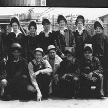 [Photograph of shipyard workers]