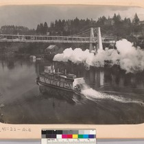 [Pomona (steamboat) on a river, going under a bridge.]