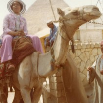 Bernice Pitts riding a camel in Cairo, Egypt