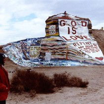 Slab City: photograph of Salvation Mountain with artist Leonard Knight