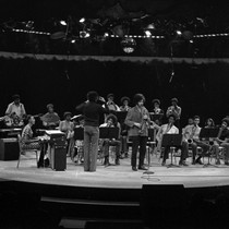 CAA orchestra on a round stage - front view