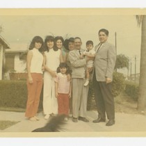 Barajas family in front of a residence, Los Nietos, California