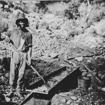 Andy at sluice box, Auburn Ravine, Calif., in the early 1850s