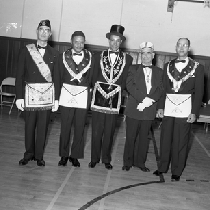 Al Fulcher (third from the left) and three men in mason regalia