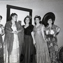 Five women entertainers facing camera