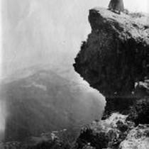 Woman atop Profile Rock on Mount Tamalpais, circa 1901