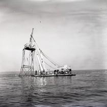 Oil drilling rig out at sea near Newport Beach, California: Photograph