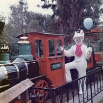 Easter Bunny standing in engine car of Frontier Village Railroad