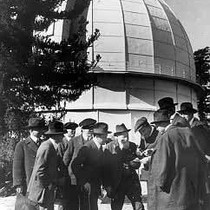 "100"" dome with group of unidentified men"
