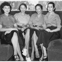 Four waitresses, all similarly dressed, seated in restaurant dining booth, Slim Jenkins ...