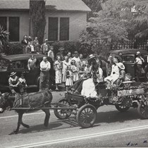 "The 1947 Cherry Festival Parade, a ""donkey"" pulling the cart"