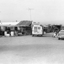 Slab City: photograph of desert housing and vehicles
