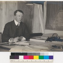Arthur Brown, Jr. seated at desk
