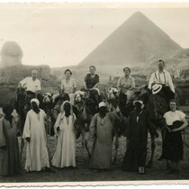 Group portrait on camels at Giza Pyramids in Egypt, 1949