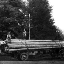 Men on lumber truck near Laguna Beach, California: photograph