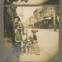 [Children with adults, Chinatown.]