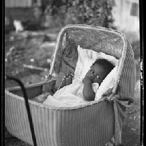 Baby in wicker carriage