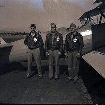 Cadets posing with PT-13 Stearman trainer