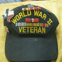 Baseball Cap With Hat Pins, Campaign Ribbons, and the inscription World War ...