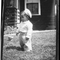 Baby standing in front yard