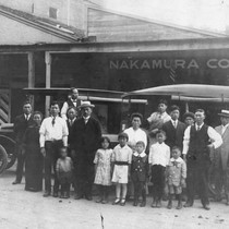 Japanese Americans in front of the Nakamura Company building with two delivery ...