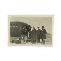Director J. Gordon Edwards with a woman and two men next to ...