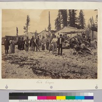Fort Tongass [Group of native Alaskans, with buildings and totem poles in ...