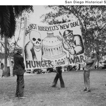 Two men holding an anti-New Deal sign at a Communist demonstration in ...