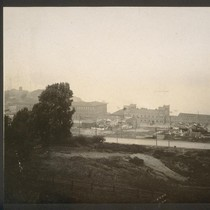 [Factory grounds, seen from south.]