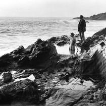 Woman wading in tide pool at Laguna Beach, Calilfornia: Photograph