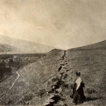 Botanist Alice Eastwood stands along the fault trace, near Olema, following the ...