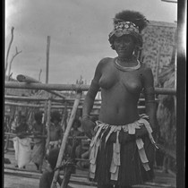 Adamase, a Motu woman of Gaile village wearing head piece, and kina, ...