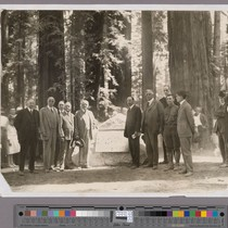 Group of men standing next to the Bolling Grove memorial plaque at ...