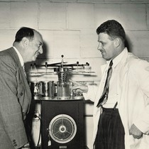 Ben Swig and Gerson Biskind, MD, reviewing lab equipment