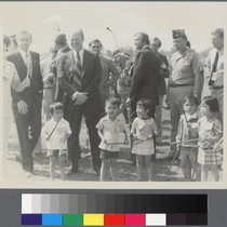 President Gerald Ford standing with children