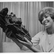 Jeannie M. Langley holds remains of logs that formed the corner of ...