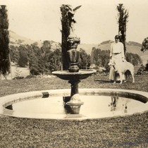 Alice Oge standing at the lower fountain at the Beale house in ...