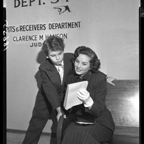 12 year-old Dean Stockwell and Colleen Townsend waiting at court for contract ...