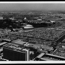 Aerial view of Disneyland Amusement Park, showing the parking lots at right, ...