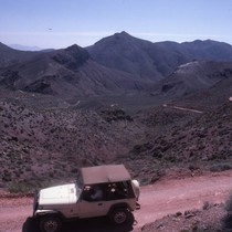 Driving a Jeep along the winding road of Titus Canyon