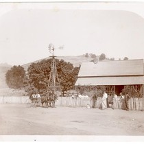 Farm scene with men, women, and children in front of a house ...