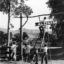 Alonim sign being hung