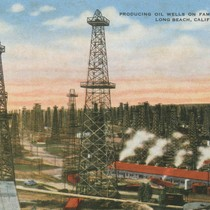 Producing oil wells on famous Signal Hill, Long Beach, Calif