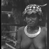 Adamase, a Motu woman of Gaile village, wearing shell head piece, and ...