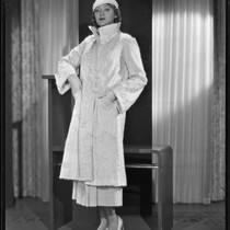 Actress Kathleen Burke modeling a fur coat from Beckman's, 1933