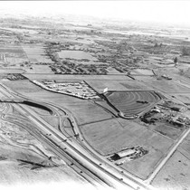 Aerial view looking southwest at the Highway 101 and Mendocino Avenue interchange, ...