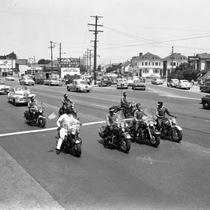 Berkeley Tigers Motorcycle Club riding in parade, Oakland, California