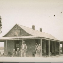 Pete Hoverly and family and their new adobe house, being the first ...