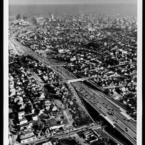 Aerial view looking down a Los Angeles freeway, showing the area adjacent ...