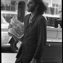 Another man selling Oracle, leaning on truck, Haight-Ashbury 1967